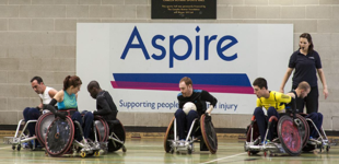 Wheelchair rugby players at the Aspire Leisure Centre